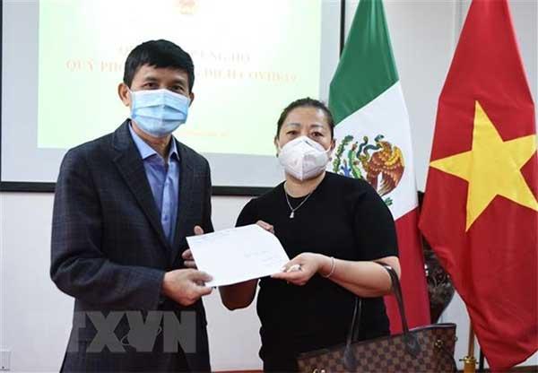 Cộng đồng người Việt tại Mexico góp sức chống dịch COVID-19